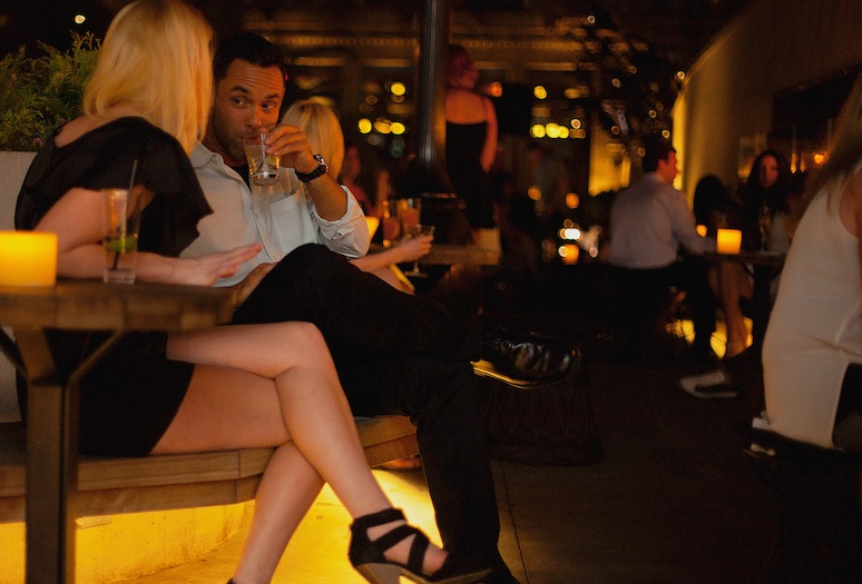 The Fun Singles in Los Angeles get together in a bar of a restaurant